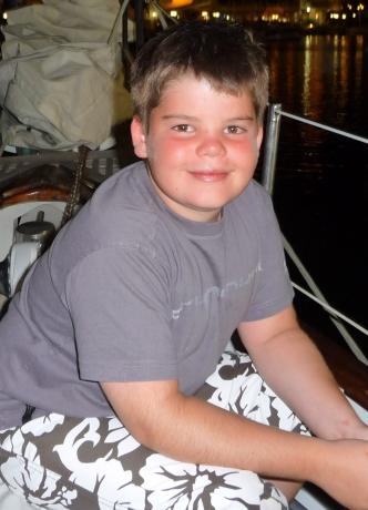 Joel on a boat